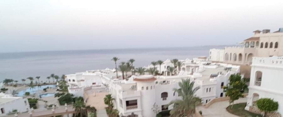 Picture of a community compound in the town of Sharm el-Sheikh with the Red Sea in the background, taken from one of the houses in the compound.