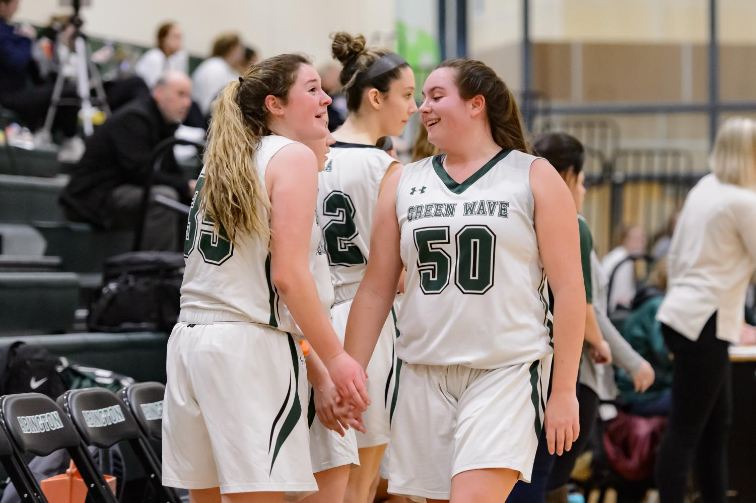 In the January 27, 2019 game against the Hull Pirates, Abington High School senior captains Kristyanna Remillard and Madison O'Connell engage in a lighthearted moment on the court.