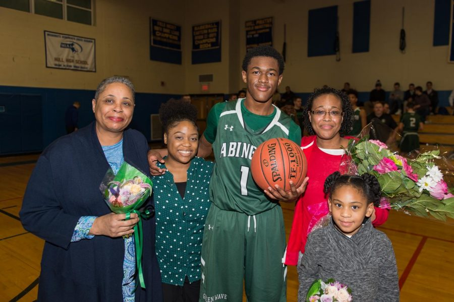 Senior Bryson Andrews celebrates after scoring his 1,000th point on Tuesday, January 29, 2019, against the Hull Pirates. Standing with Andrews (left to right) is his grandmother Margaret Andrews, aunt Gold Andrews, Bryson Andrews, mother Lillian Brice, and sister Savannah Brice.