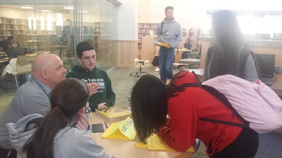 Mr. Lanner, the advisor of the ABC, speaks to interested students at Mondays Club Fair held in the library on Feb. 5, 2019. Seated next to Mr. Lanner is Brice Tolan, a senior and a member of ABC. This year, the event will be virtual on Wed., January 6, 2021 due to Covid concerns.