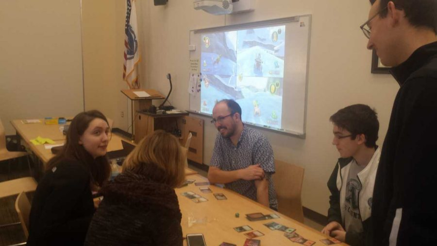 Kristen Barbara White, a junior, and Brian Tolan, a sophomore, who are the co-presidents of the Gaming Club are teaching the rules of Magic, the Gathering