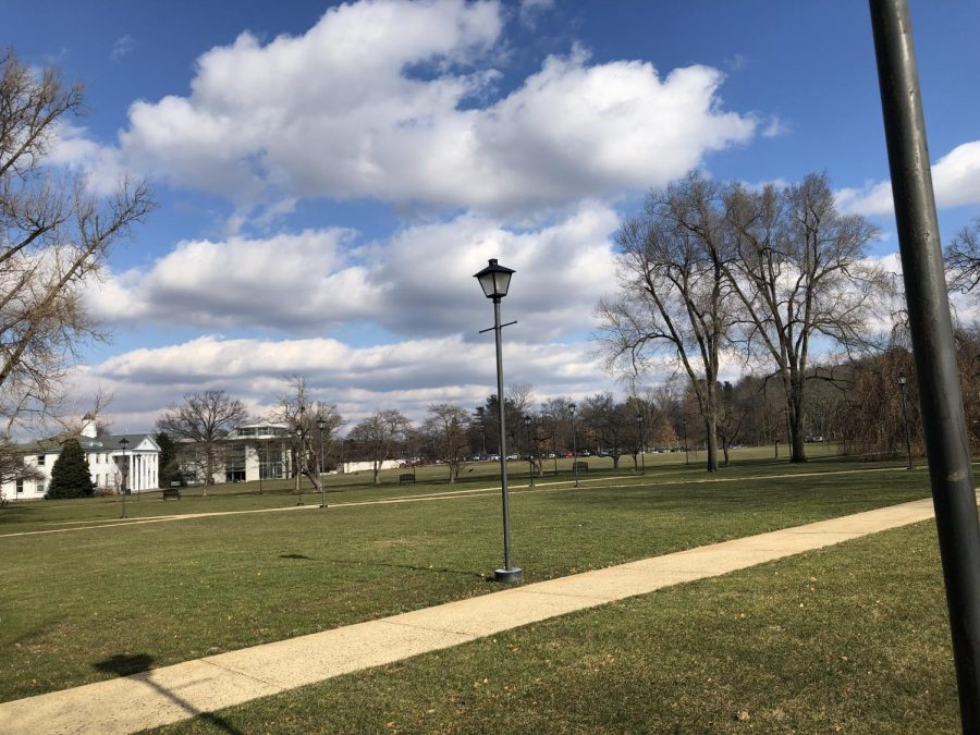 Lampposts like this one line the Quad at Delaware Valley University. The building in the back is the Life Science building beneath a blue but cloudy sky on Friday, Jan. 25, 2019