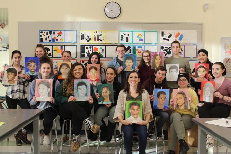Ms. Michelle Poirier and her students display portraits of the Filipino child whom they painted for The Memory Project. Seated left to right are sophomore Kaitlyn Scartissi, junior Jessica Rix, sophomore Cecelia Lindo, Ms. Poirier, junior Jonathan Aiello, senior Abi Edwards, and sophomore Madelyn O'Leary. Standing left to right are seniors Nicole Marella, Katherine Marando, and Abbiejayne Cristoforo; juniors Mikayla Kane, Trinity O'Connor, Daisy Littlefield, and Roman DeBono; and senior Laila Aboudrar.
