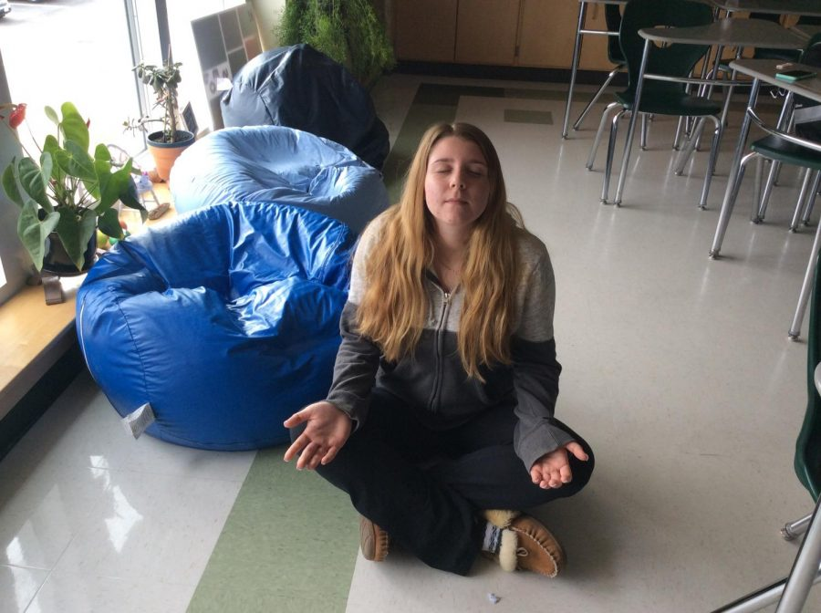 Abington High School junior Kaitlyn Polito has learned meditation practices in her period 7 Mind/Body/Spirit class with Mrs. Daisy. Here she is in English class, having completed her class assignment on Friday, March 29, 2019.