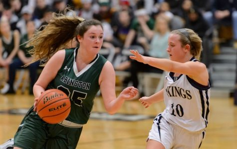 Senior captain Kristyanna Remillard drives to the hoop against an opponent during the Abington vs. East Bridgewater Quarterfinals on March 2, 2019.