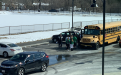 After school, Abington students board one of the three fan buses to the State Semi-Finals at the TD Garden in Boston on Tuesday, March 12, 2019.