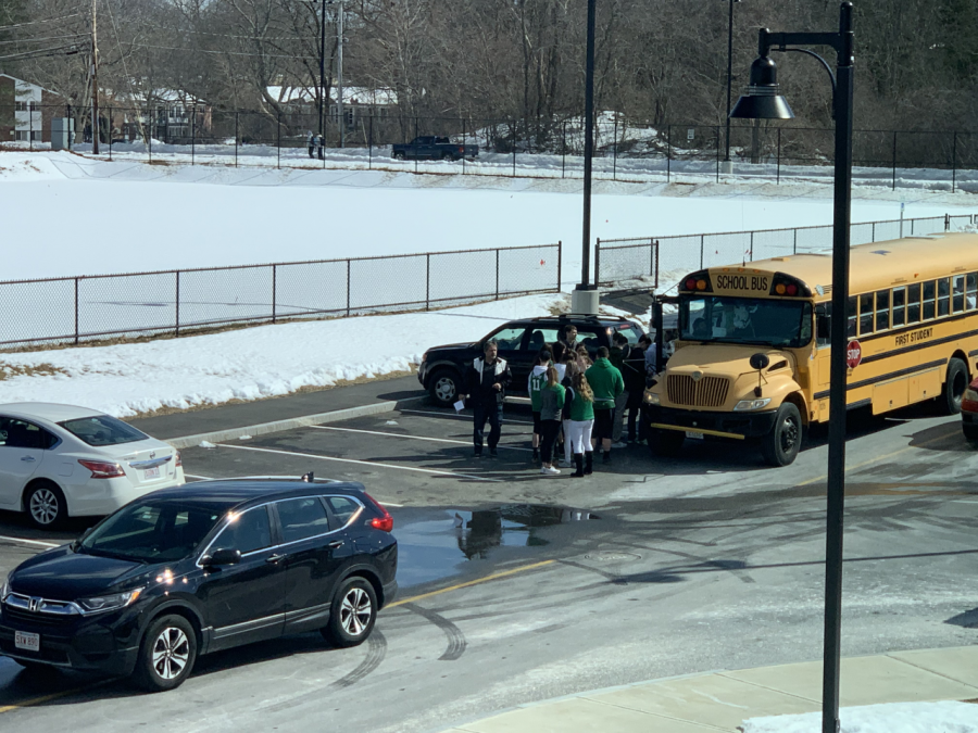 After+school%2C+Abington+students+board+one+of+the+three+fan+buses+to+the+State+Semi-Finals+at+the+TD+Garden+in+Boston+on+Tuesday%2C+March+12%2C+2019.