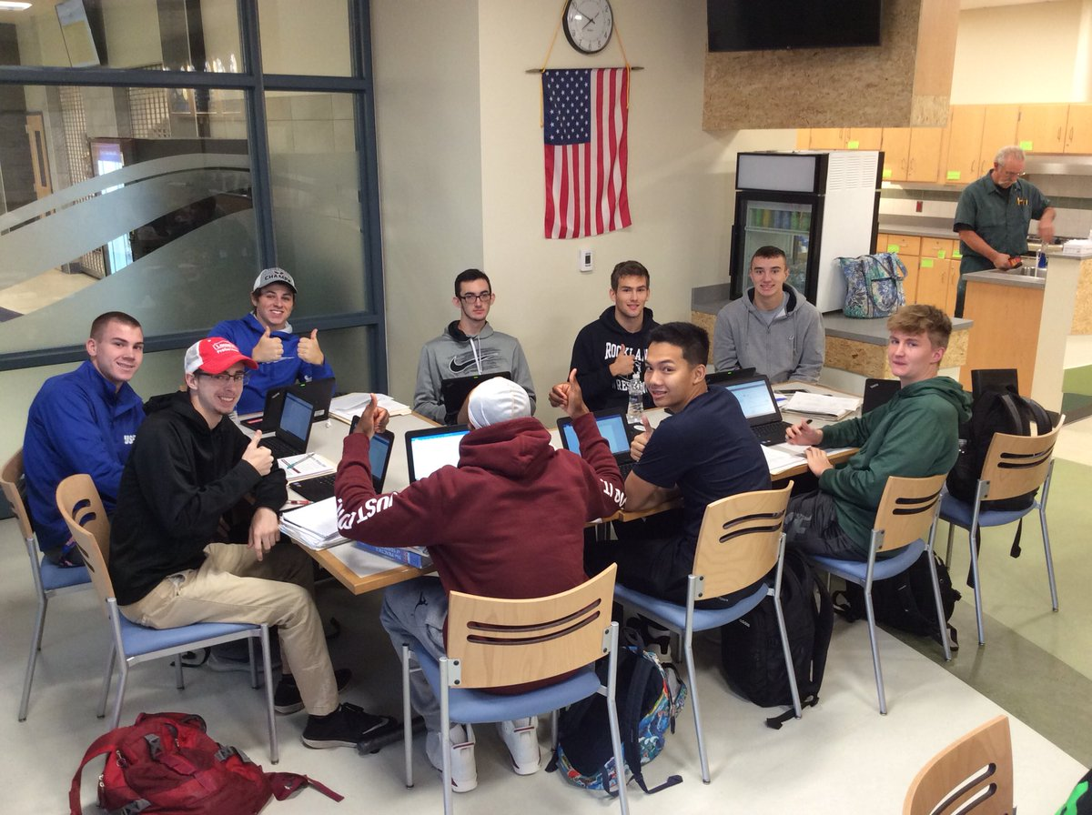 Seniors in period one English class enjoying breakfast in the Green Wave Cafe while doing classwork on their one-to-one devices. Photo taken September 25, 2018. From left to right: Justin Maskell, Craig O'Connor, Ryan Doherty, Justin Murphy, Tommy Tashjian, Christian Lebossier, Michael Boyle, Tony Dao, and Bryson Andrews (back to).