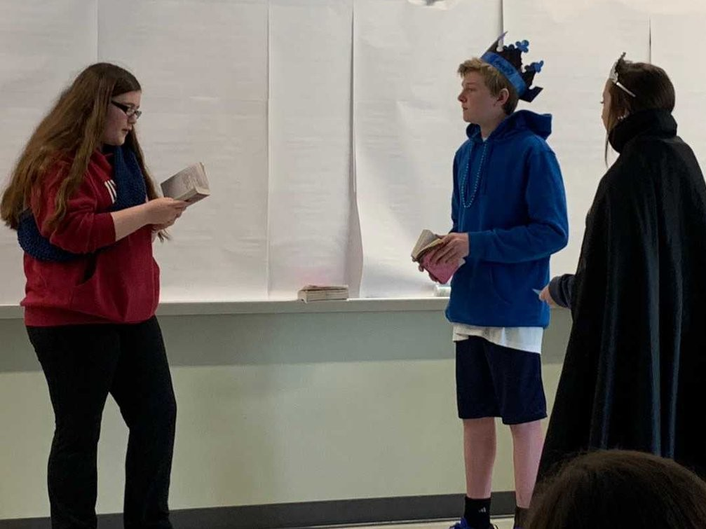 Freshmen+in+Ms.+Pflaumer%27s+English+class+perform+Romeo+and+Juliet.+Here+Benvolio%2C+played+by+Gretchen+Mueller%2C+is+questioned+by+Romeo%27s+parents+Lord+Montague%2C+played+by+Josh+Flaherty+and+Lady+Montague+played+by+Arianna+Townsend.