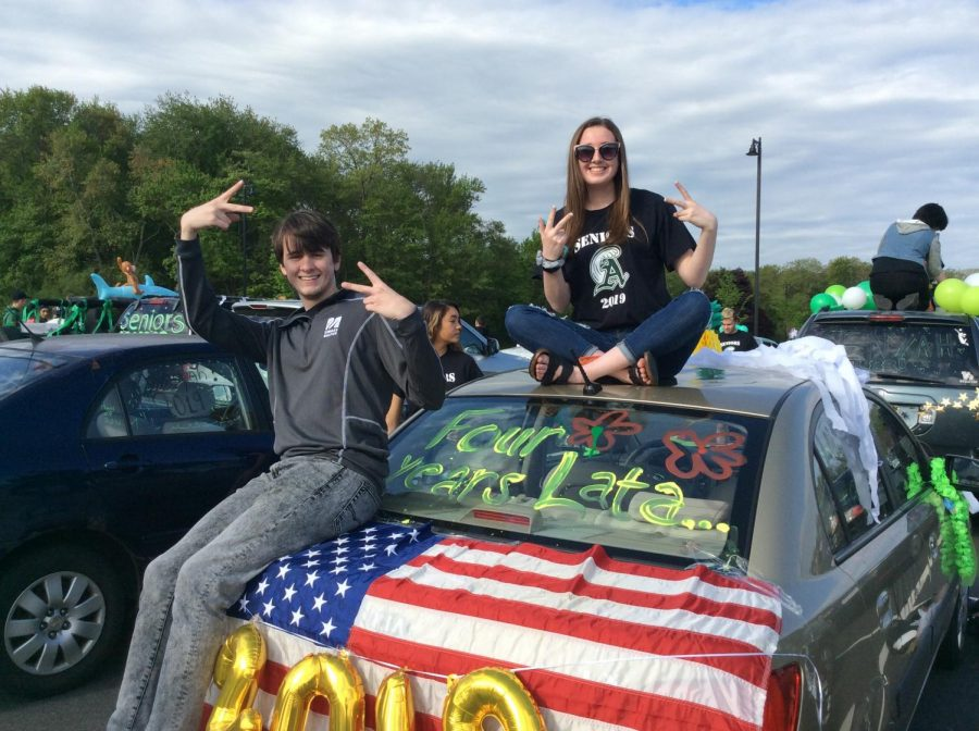 Seniors Kyle Neilan and Carly Goldberg celebrate their last day as students at Abington High School, May 23, 2019.