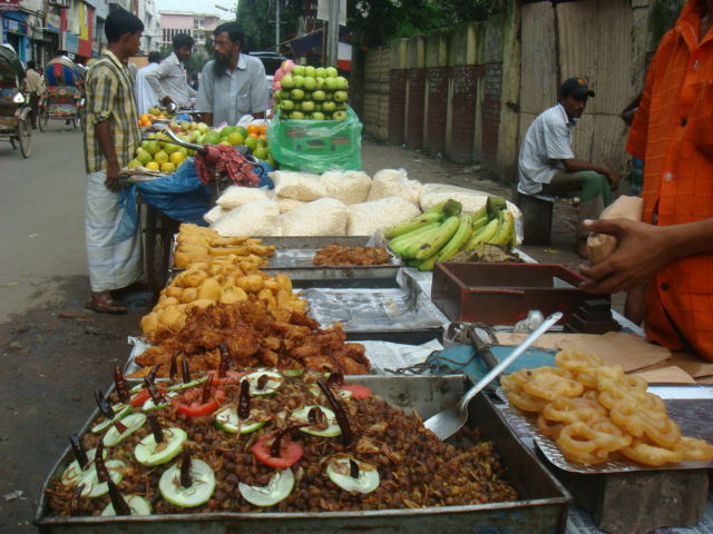 During break of fasting (Iftar) food vendors are seen all around corner streets selling delicious snacks. The vendors compete by seeking customers attention with fanfare.