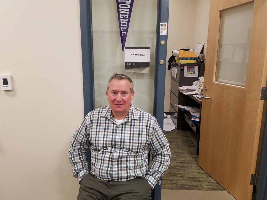 Mr. James Donohue, Special Education Coordinator at Abington High, sits outside his office in the guidance wing on Wednesday, May 1, 2019.