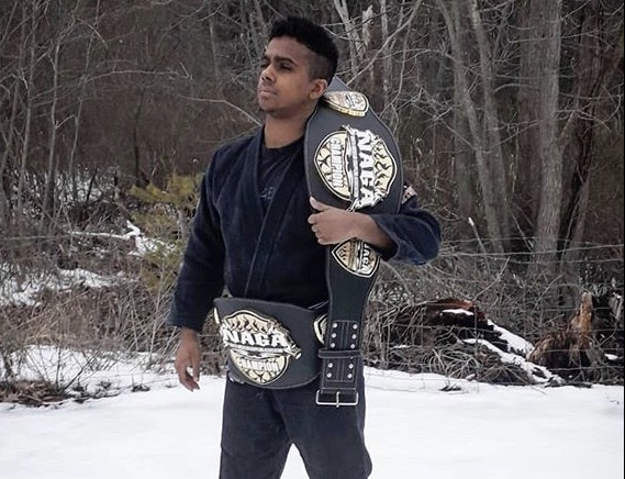 Abington Freshman Helvecio Junior with two of his North American Grappling Association Championship belts. 2019.