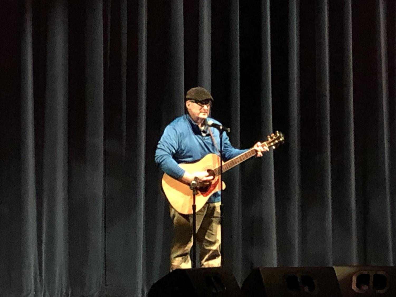 Mr. Jim Dorman plays a cover song at Open Mic held in the Abington Middle-High School Auditorium on May 8, 2019. Besides working in education at Abington High, Mr. Dorman is a freelance writer covering the entertainment industry on the South Shore.