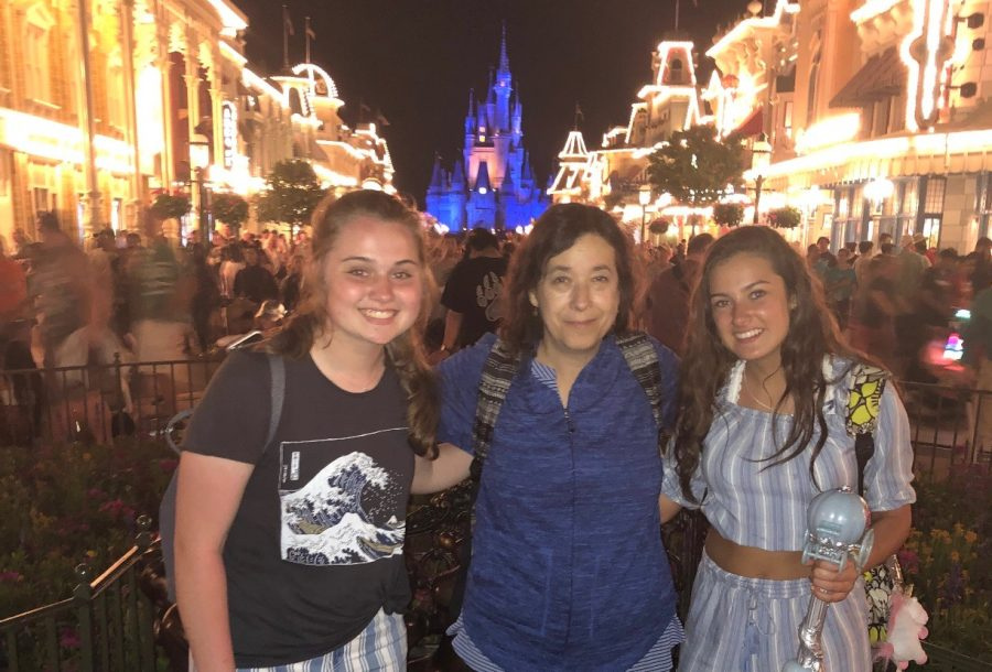 Abington Music trip to Walt Disney World in Orlando Florida, on April 26, 2018. Left to right: Abby Joyce ('21), Mrs. Joyce Harrington, and Lyla Blanchard ('21) in front of Main St. and Cinderella's Castle.