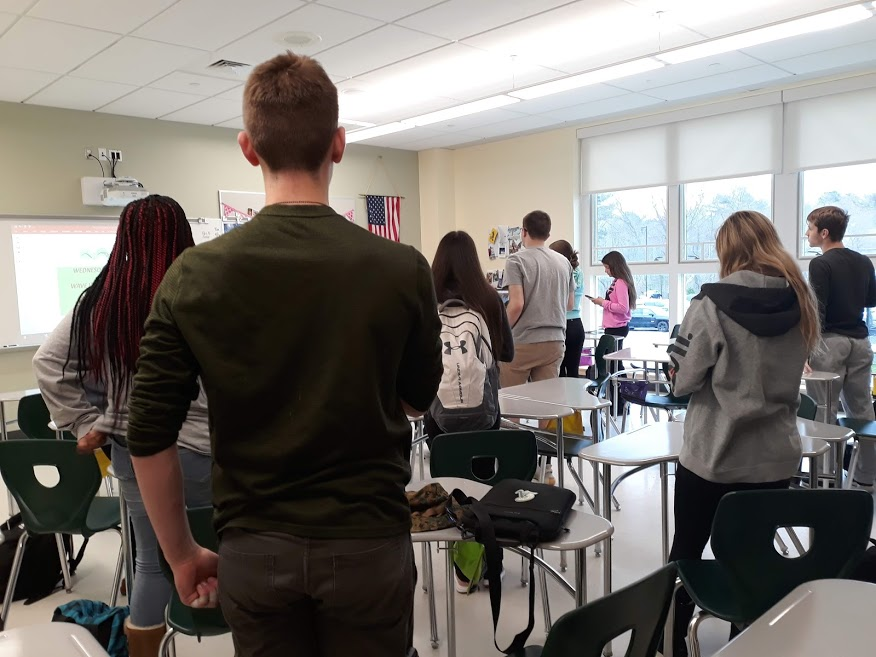 Students at Abington High School in Ms. McHugh's homeroom stand for the Pledge of Allegiance before school begins.