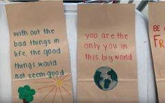 Students at Abington High School decorated paper lunch bags with positive sayings for the Soupman project. September 2019.