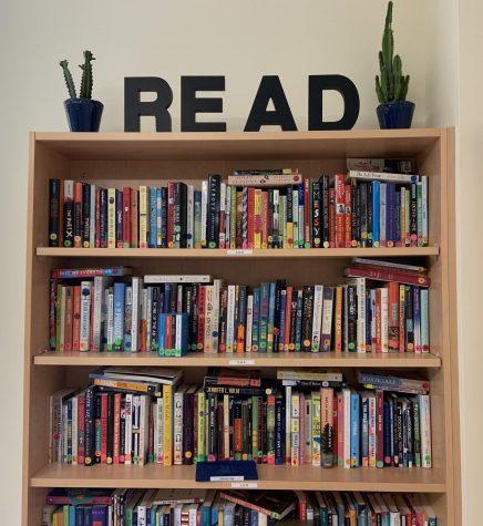 This bookcase seen in English classroom room 2215 on Tuesday, Oct. 1, 2019 is overflowing with books encouraging students to read.