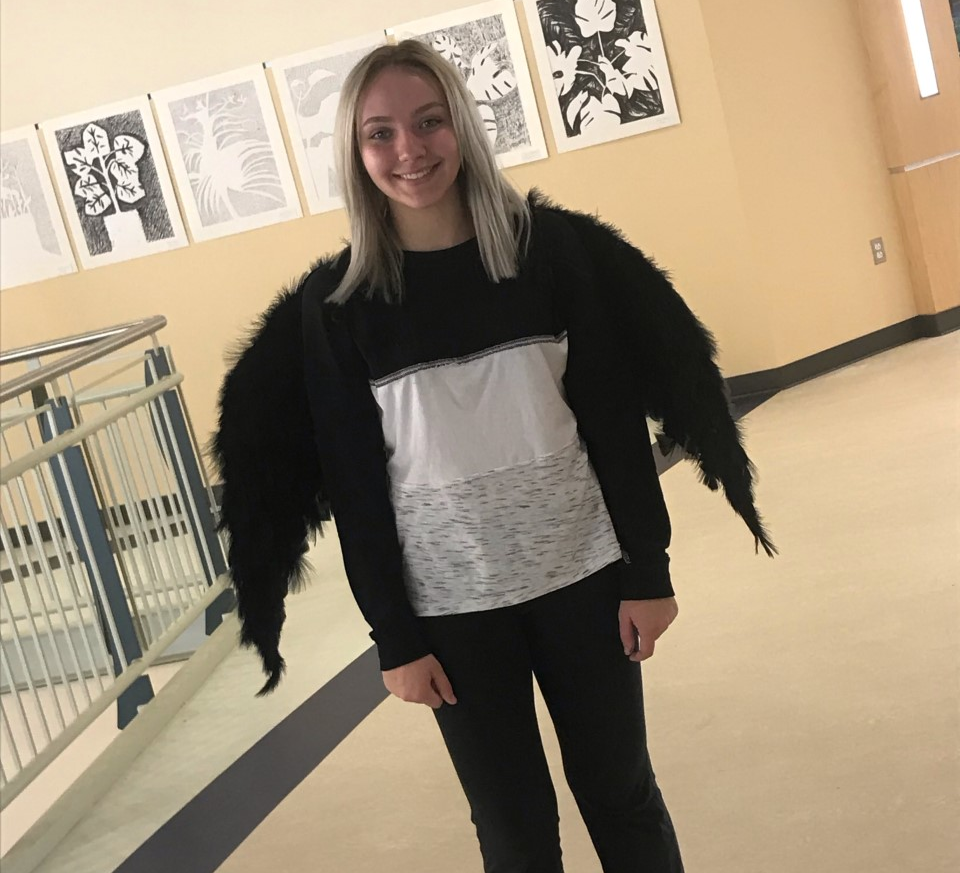 Marguerite+%22Maggie%22+Mayer-Eirnstein%2C++a+senior+at+AHS%2C+with+her+wearable+art.+Mayer+participated+in+the+fashion+show+on+Monday%2C+October+7%2C+2019+at+the+high+school+during+period+7+outside+of+the+library.