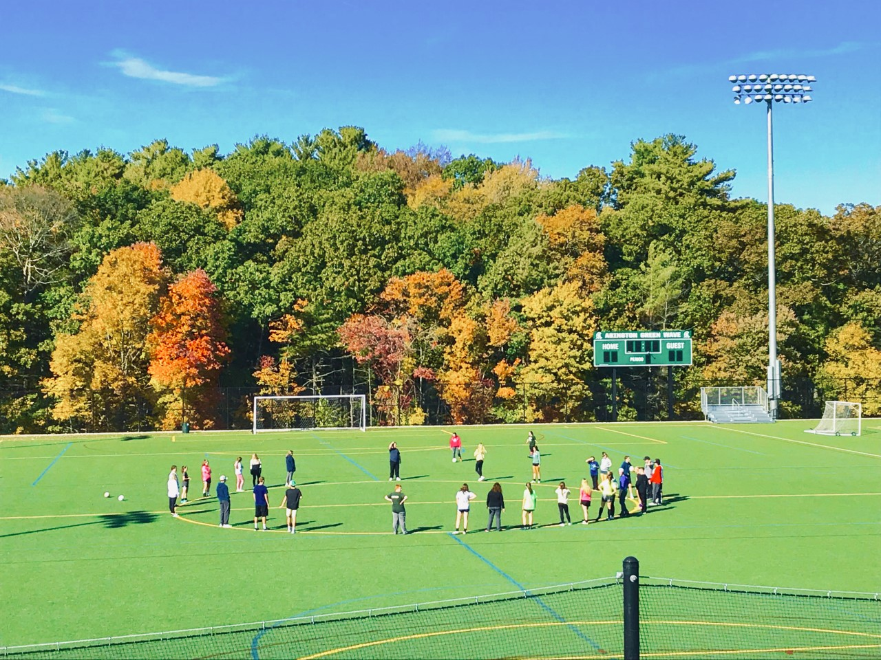 Students gather on the afternoon of Tuesday, October 15, 2019 on the field behind Abington High School.