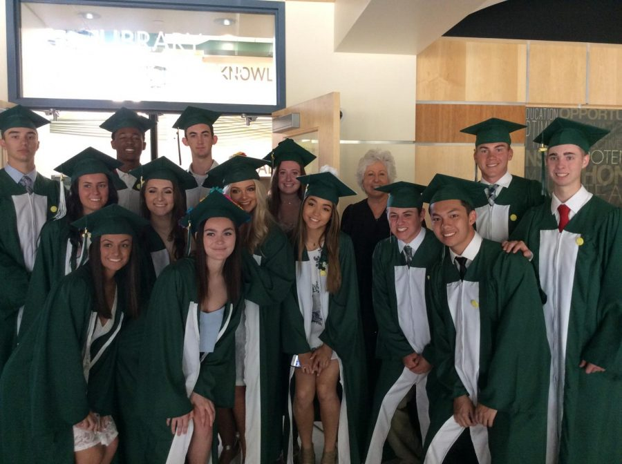 Abington High School seniors outside the library prior to their graduation ceremony in the auditorium on June 1, 2019. Front row Maddie Contrino, Jane Clark, Criselda Burke, Ryan Doherty, Tony Dao. Behind them are Christian Labossier, Maureen Stanton, Bryson Andrews, Christina Varney, Justin Murphy, Hanna Thurberg, Carly Goldberg, Ms. Pflaumer, Craig O'Connor, and Justin Maskell.