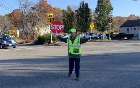 On November 6, 2019, crossing guard Ms. Mary Ann Mattes helps students cross the busy intersection of Rt. 18, Lincoln Blvd., and Gliniewicz Way in Abington.