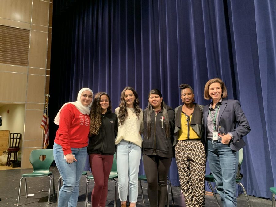 On Friday, October 25, 2019 in the Abington High School auditorium, storytellers from Suitcase Stories, as well as three Abington High School students, share their experiences.  From left to right are Abington senior Shaam Nasser, sophomore Haekela Haraujo, storyteller Mackenzie Vieira, AHS freshman Stephany Alfaro, and storytellers U-meleni Mhlaba-Adebo and Anna Fletcher
