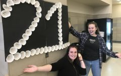 Maura Odell (left) and Rachel Barrett, as juniors at Abington High School, decorating the cafeteria in preparation of the 2019 Pep Rally