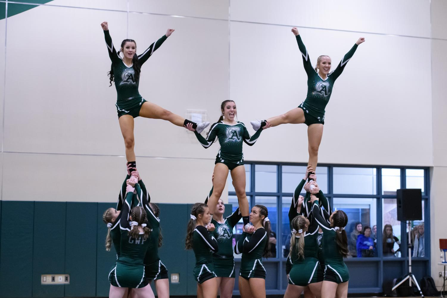 Junior+Carolyn+Doherty+%28left%29%2C+sophomore+Lindsay+Augusta+%28center%29%2C+and+junior+Leah+Kinniburgh+%28right%29%2C+fliers+with+Abington+High+School+cheer+perform+a+routine+on+Wednesday%2C+Nov.+6%2C+2019+in+the+Abington+Gym.