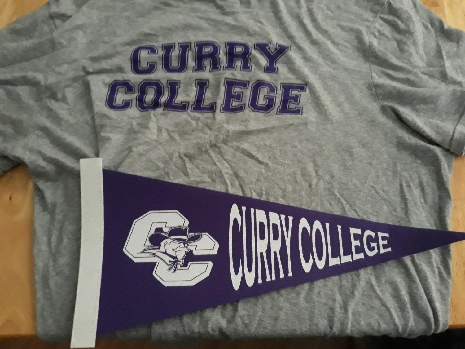 Curry College's athletic teams are known as the Colonels. The school's colors are purple and white, as shown in this pennant and T-shirt with Curry College's insignia.