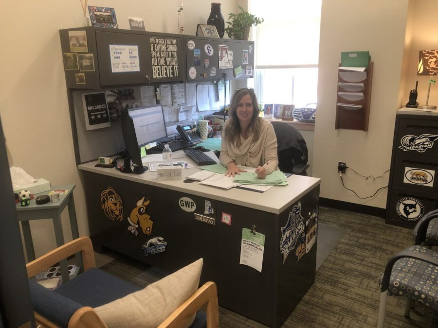 Ms. Ferioli working on student's college applications on Thursday, November 14, 2019 in her Guidance department office at Abington High School.