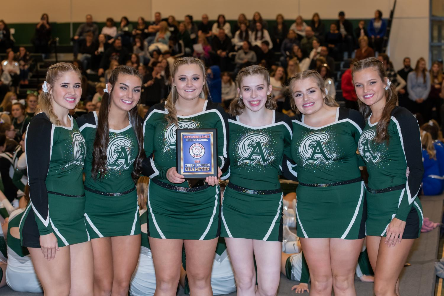 Seniors (left to right): Haven DiMambro, Julie Warsheski, Kerry Cardinal, Erin McDermott, Mikayla Littman, and Emmalee Ezzell posing with their first place plaque at the cheerleading competition held on Wednesday, November 6, at Abington High School.