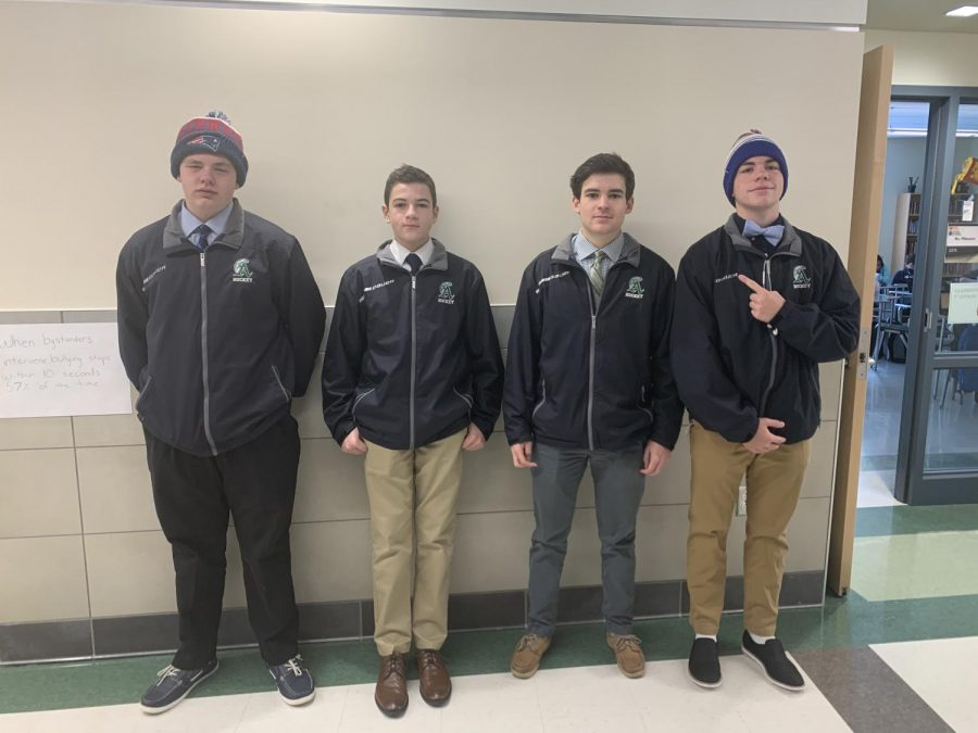 Abington boys hockey suits up to get ready for their game tomorrow at 7:40 p.m. at the Rockland Rink. Left to right, sophomore Jack Shea, freshman Spencer Merrick, and juniors Connor Buckley, and Brendon Grafton.