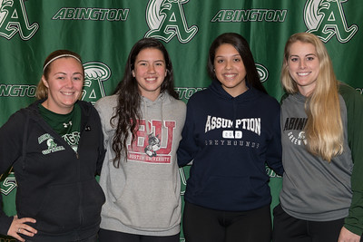 Softball coaches Kristen Reardon (left) and Kelsea Cheney (right) with seniors Lauren Keleher (BU) and Corin Mahan (Assumption) during the Letter of Intent signing held after school at Abington High School on November 18, 2019.