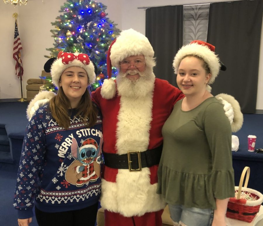 Abington residents and Senior Center volunteers Kathryn Sage author of this article) and Cameron Ranous stand with Frank Burke, or Santa Claus, at the Abington Senior Center, photographed on December 14, 2019