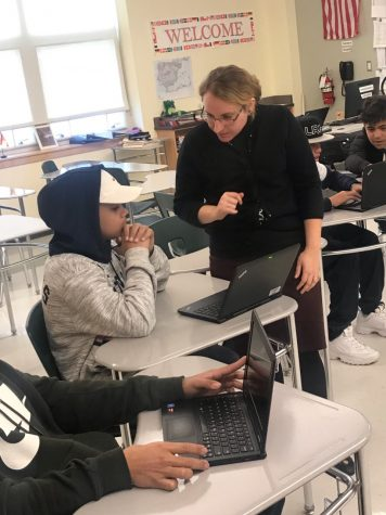 Mrs. Despres, an English as a Second Language teacher at Abington High school, helps one of her students with his assignment during semester one.