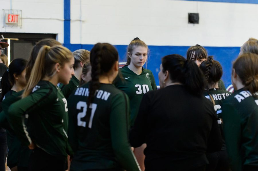 Coach Judy Hamilton (in black) speaks to her players during the tournament volley game held in Kingston at Sacred Heart on November 2, 2019