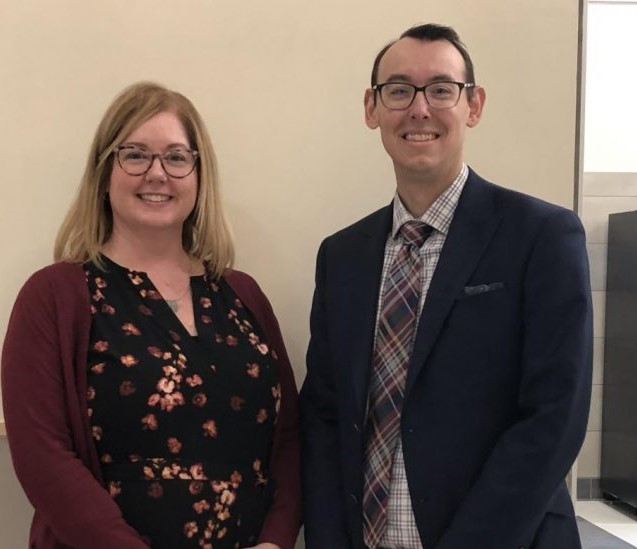 Mrs. McHugh is co-advisor of both the high school yearbook, along with fellow ELA teacher Ms. Slayton, and the National Honor Society, along with Mr. Scott (pictured here during the NHS Induction Ceremony held on November 13, 2019)