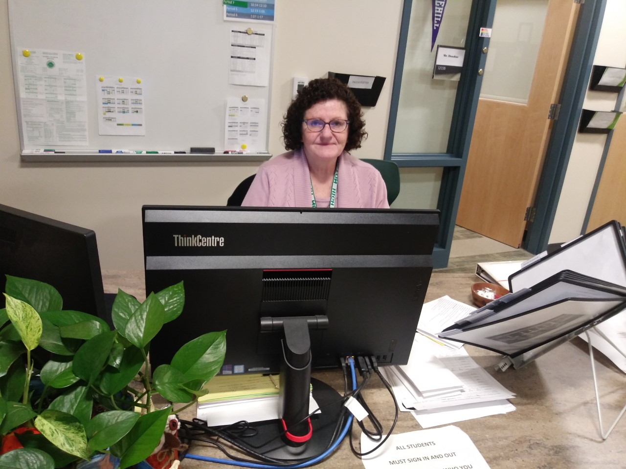 Mrs. Paula Potter, Guidance Secretary at Abington High, sitting in her office in the guidance wing on Monday, December 9, 2019.