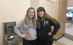 Abington High School senior twin sisters Ailey (left) and Manda Riddick (right) pose next to each other in the athletic hallway on Wednesday, December 11, 2019.