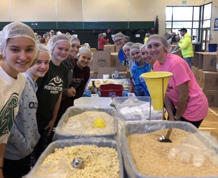 Members of the Abington Girls Soccer Team help to package food during the community event, held in the gym, on Friday, November 22, 2019. Over 600 people donated to the effort of making 250,000 meals. Pictured (left side, front to back): Hannah Tirrell, Ellie Lindo, Delaney McCann, Zoe Balewicz, Carrie Prewitt. (right side, front to back): Gracie OConnell, Isabella OConnell, Caitlin Noble, Cecelia Lindo, Ava Bickford