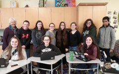 The Green Wave Gazette Staff meeting on Tuesday, January 14, 2020. Staff members include junior Abby Joyce, freshman Amaya Turner, and sophomore Maria Wood. Standing left to right is the advisor Ms. Pflaumer, juniors James Mulkern and Lily Bonner, freshmen Acadia Manley and Iris Hijier, and sophomore Taylor Frye. On the far right, standing are Anna Blyth and Rohith Ghose who each contributed an article to the newspaper.