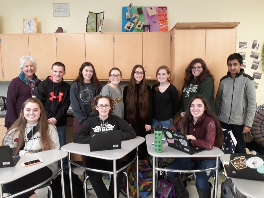 The+Green+Wave+Gazette+Staff+meeting+on+Tuesday%2C+January+14%2C+2020.+Staff+members+include+junior+Abby+Joyce%2C+freshman+Amaya+Turner%2C+and+sophomore+Maria+Wood.+Standing+left+to+right+is+the+advisor+Ms.+Pflaumer%2C+juniors+James+Mulkern+and+Lily+Bonner%2C+freshmen+Acadia+Manley+and+Iris+Hijier%2C+and+sophomore+Taylor+Frye.+On+the+far+right%2C+standing+are+Anna+Blyth+and+Rohith+Ghose+who+each+contributed+an+article+to+the+newspaper.