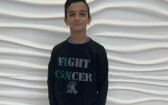 Freshman Joseph Hajjar of Abington High School wears a Blackout Cancer long sleeve T-shirt on Monday, January 13, 2020. T-shirts are being sold by SAAC and all proceeds will go to cancer research and helping those affected by the disease.