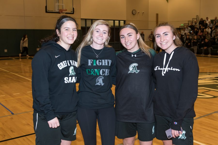 Members of the SAAC group talking to the people at the game about Blackout week. from left to right, senior Lauren Kelliher, Keriann Danahy, junior Isabelle OConnell, and Gracie OConnell