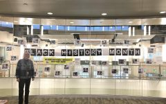 On Tuesday, February 11, 2020, Abington Middle-High School Library and Media Specialist Mrs. London stands inside the library. On the glass is the photo contest to celebrate Black History month.