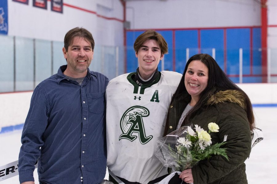 Senior assistant captain and goalie Drew Wilson with his parents on Senior Night on Wednesday, February 5, 2020.