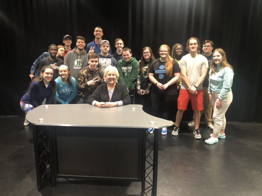 Abington High School's journalists in the CAM studio on Friday, February 7, 2020. Front row Maria Wood, Kayla Larkin-Goodman, Jack Clifford, Ms. Pflaumer. Behind them left to right Vincent Kariuki, Sean Moran, Chris Lussier, Joao Andrade, Cam Curney, Jake Bennett, Derek Tirrell, James Mulkern, Haley Cooper, Emily Christian, Linda Daye, John Mueller, Rob Tashjian, and Kathryn Sage. Missing in the photo is Troy Brown.