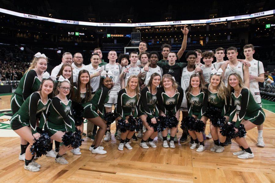 Abington Boys basketball team and the girls varsity cheerleading team celelbrating the win at the TD garden on March 10, 2020
