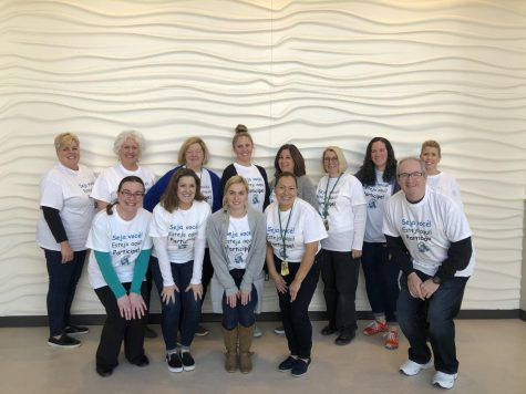 "Abington High School teachers and staff show their support for English language learners by wearing T-shirts on Monday, March 2, 2020 that say ""Seja voce! Estaja aqui! Participe! to begin the celebration of International Week. Front row left to right: Ms. Farias, Ms. Peck, Ms. Cutter, Ms. Solano, Mr. Dorman. Back row left to right: Ms. Coakley, Ms. Pflaumer, Dr. Gonsalves, Ms. Wakelin, Ms. Kitterick, Ms. London, Ms. Kenealy, and Ms. Posk."